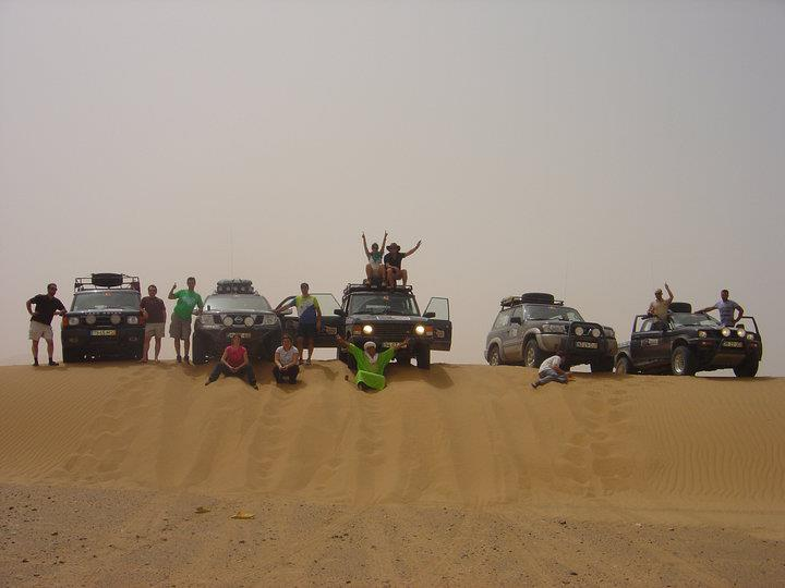 Tourists and 4X4 cars in the Sahara desert